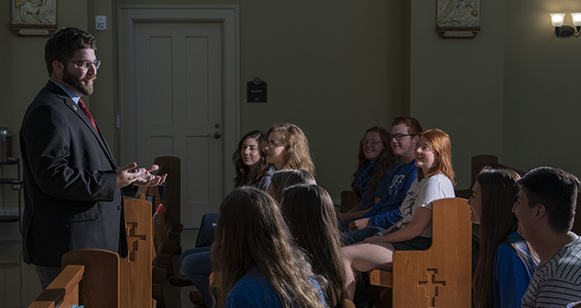 Students listening to Justin in the Chapel.
